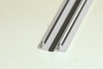 This is a co-extruded profile, where the black areas are flexible and the main body is rigid.  This allows the profile to hinge in the middle.